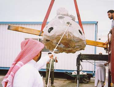 qatar8.jpg - This Pallet Ball is lifted onto a truck donated to the Science Club for the project by the Qatar Government.