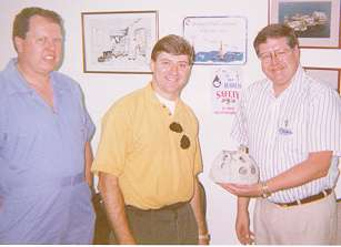 qataroxyfolks.jpg - Todd Barber presents a model Reef Ball to Occidental for their assistance in bringing this project to life!