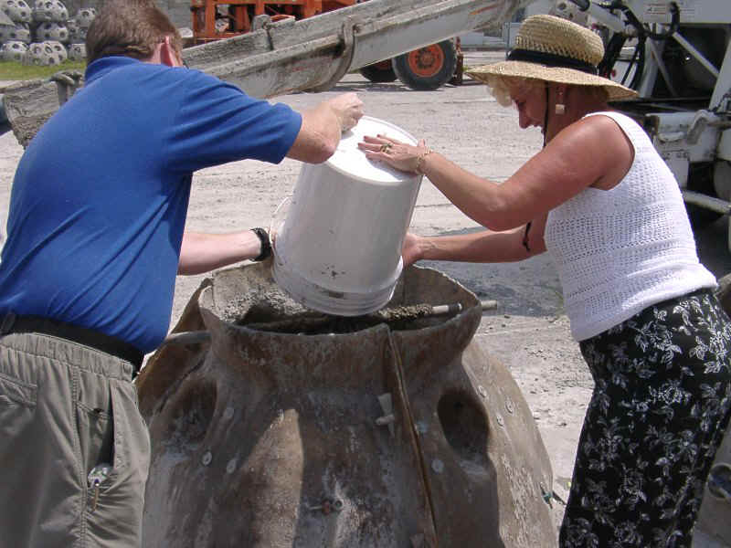 06270016.jpg - A Mother helps mix her son's remains into the concrete to form the Memorial Reef.