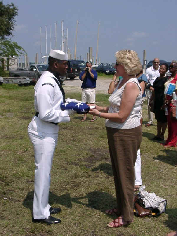 07200045.jpg - The families are presented with the flag by the representative of the nation they served.