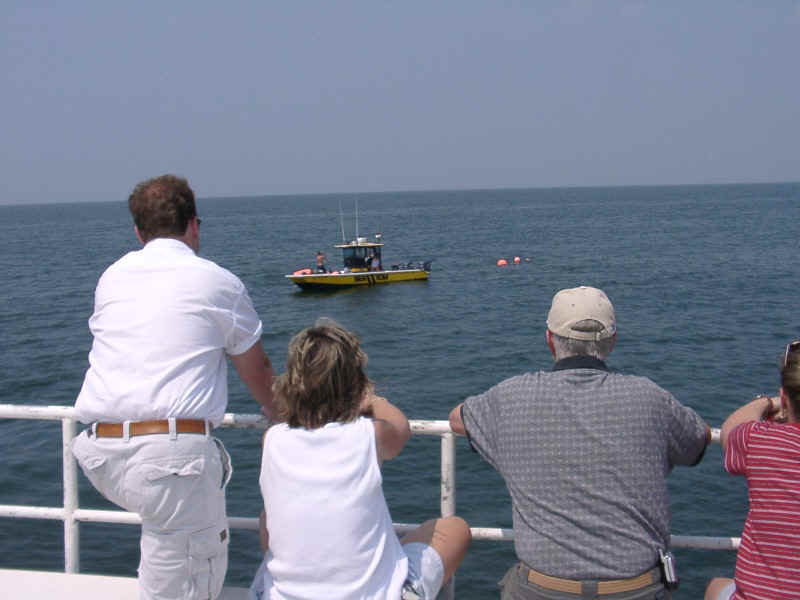 07210027.jpg - Some families sit on top of the charter to witness the the placement of the Memorial Reef .